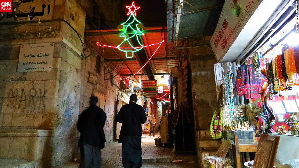 "This photo of a couple of priests walking through the Christian Quarter in Jerusalem was taken by James Cheatham, who has lived and worked on and off in the city since 2002.<br /> <br />""When I was walking through the Christian Quarter, several of the shops had Christmas music playing such as Bing Crosby (White Christmas), Nat King Cole (Chestnuts Roasting On An Open Fire), and O Holy Night, amongst others which really added to the atmosphere,"" said the native Californian."