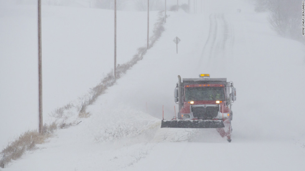 A snowplow makes its way along a county road in Waupun on December 20.