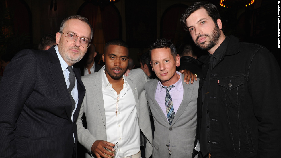 """Addicted to sneakers"" as a youngster, Nas got a reputation for fashion in his later years. Here, he poses with GQ's Jim Moore, Jim Nelson and Will Welch at a party for the launch of the magazine's April 2012 issue at New York's Jane Hotel."
