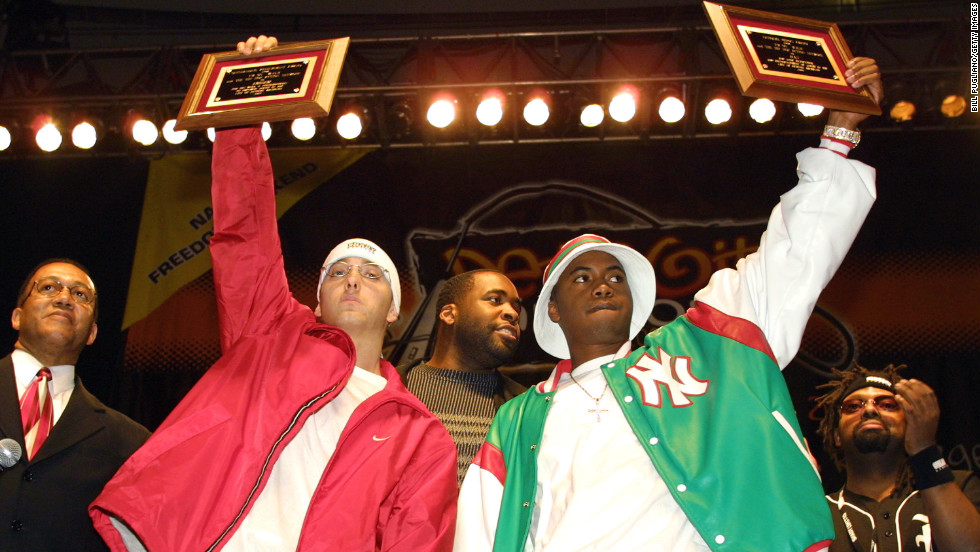 Eminem, left, and Nas hold up awards from then-Mayor Kwame Kilpatrick at the Detroit Hip Hop Summit in 2003. Nas says guys like Eminem, who dropped his first album in 1999, push him to be a better rapper.