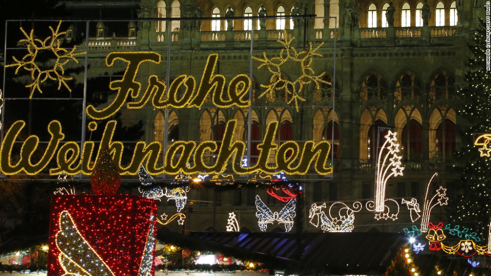 The decorative lights of Christkindlmarkt in Vienna twinkle in the night sky.