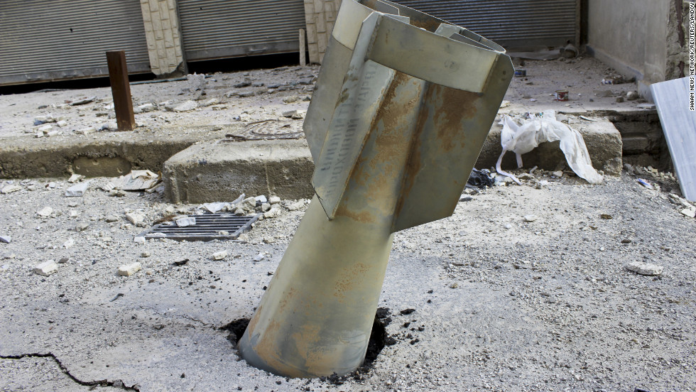 An unexploded bomb is seen lodged in a street in Ghouta, east of Damascus, Syria, Wednesday, December 19.