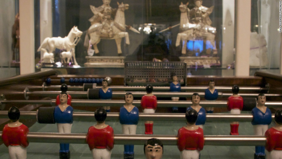 A football table stands in front of marble carvings in the palace. Some of the artifacts in the palace include gifts from foreign leaders, and cloaks and jewellery belonging to the former king of Tunisia, which will be retained by Tunisia's Ministry of Culture.