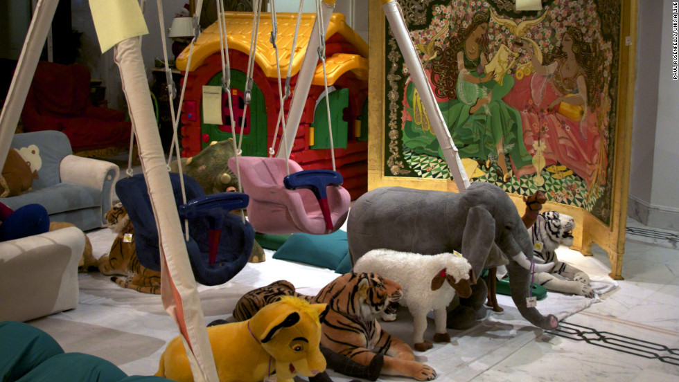 A child's playground in the palace, which would have been used by Ben Ali's son and heir, Mohamed, aged seven or eight. Books on parenting were found inside the palace, along with a biography of former French first lady Carla Bruni and a guide to media law.