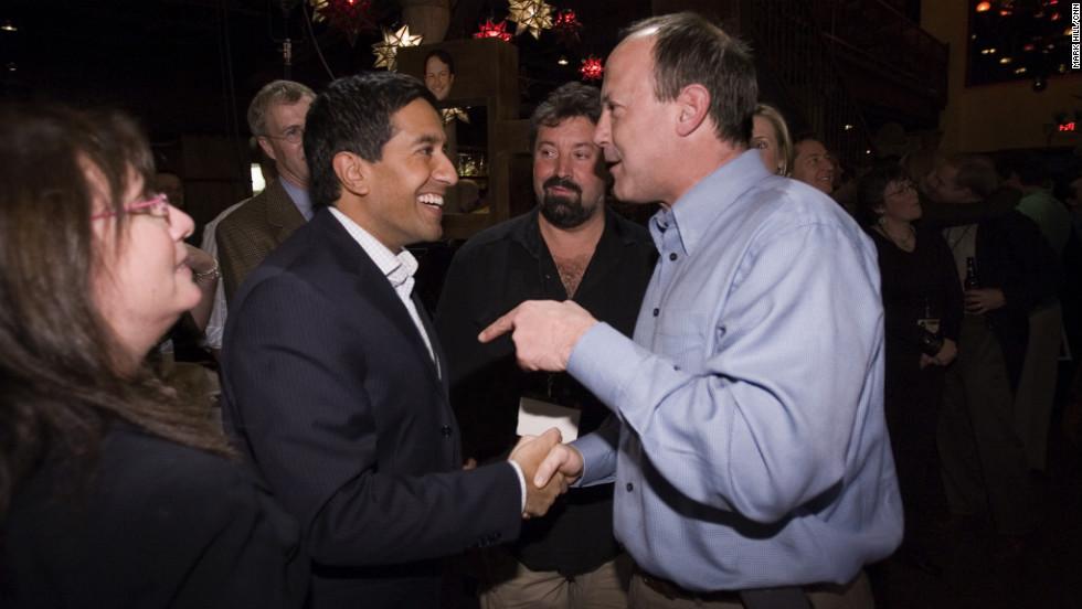 Walton, right, and Dr. Sanjay Gupta, CNN's chief medical correspondent, at the network's 25th anniversary celebration.