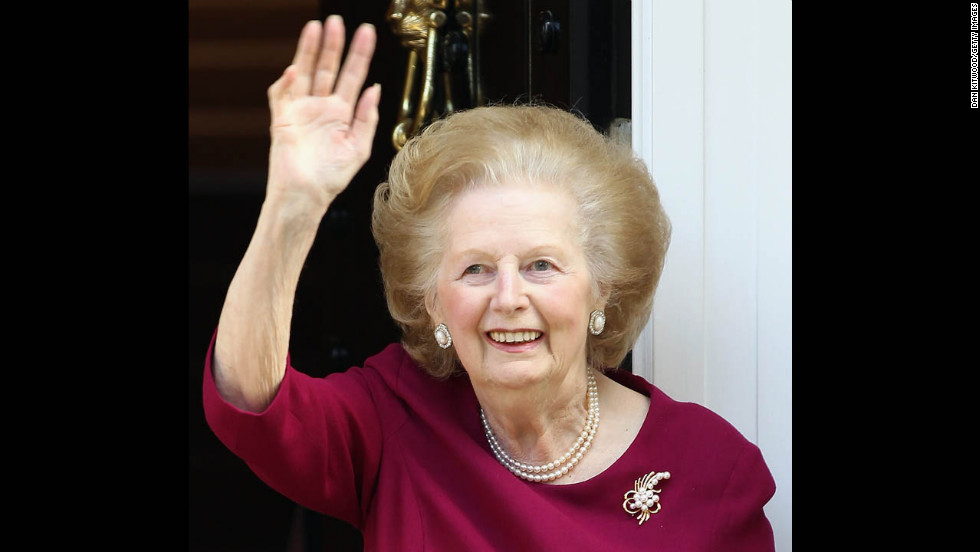Thatcher waves to journalists from her London home after another hospital visit -- this time with a bout of flu -- in November 2010.