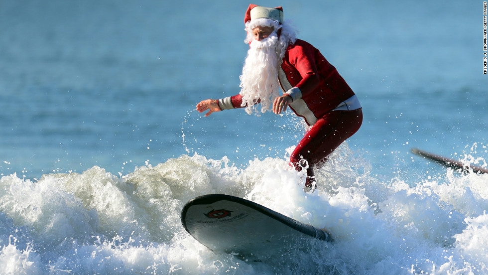 Michael Pless, 62, catches a wave off Seal Beach, south of Los Angeles, on Friday, December 21, in California. Pless, who also runs a surfing school, has been dressing up as Santa Claus and taking to the waves in costume since the 1990s, sometimes joined by his wife, Jill, in a Mrs. Claus outfit.