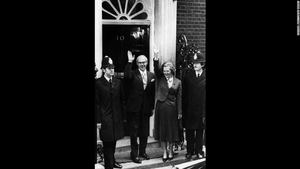 Thatcher, becoming the first female prime minister of a European country, stands with her husband, Denis, outside 10 Downing Street in May 1979 after her party's success in the general election.
