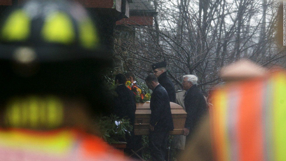 The casket of Rachel Marie D'Avino is carried into the Church of the Nativity in Bethlehem, Connecticut on Friday, December 21.