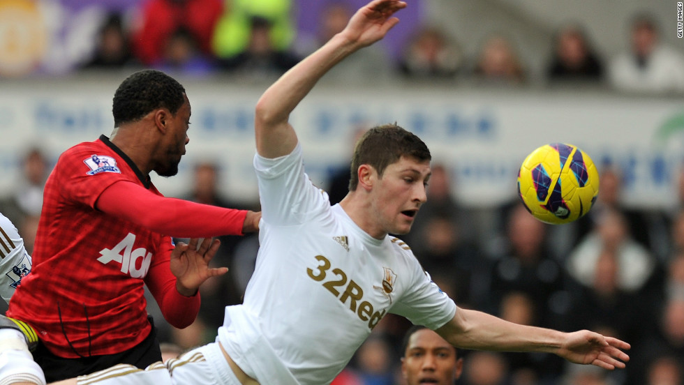 Patrice Evra gave Manchester United a 16th minute lead at Swansea after heading home Robin van Persie's corner.