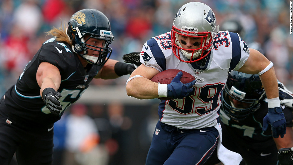 Danny Woodhead of the Patriots is tackled by Paul Posluszny of the Jaguars at EverBank Field on Sunday in Jacksonville, Florida.