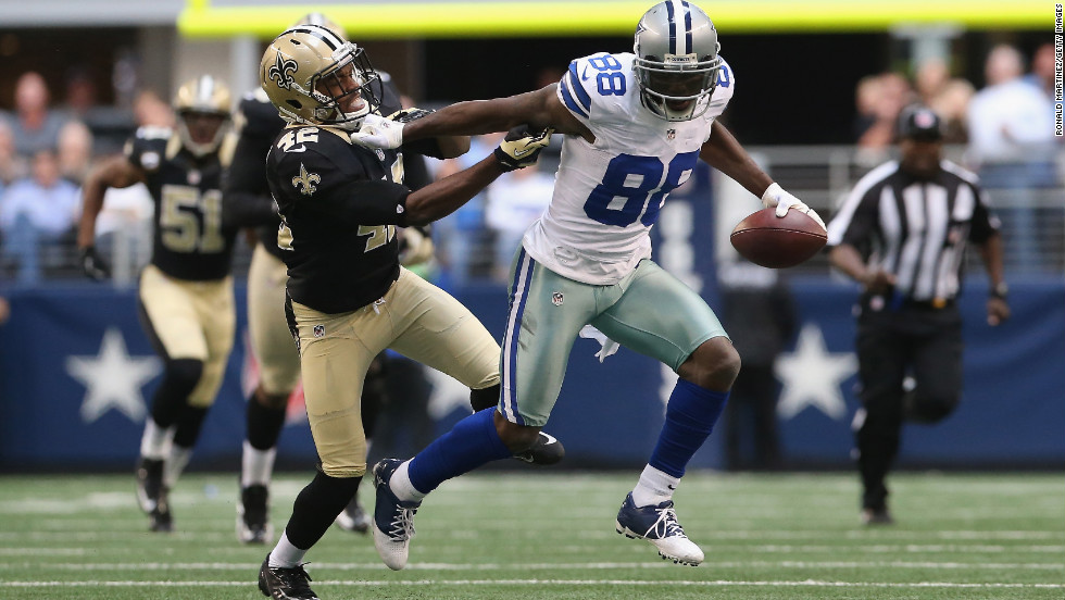 Dez Bryant of the Dallas Cowboys runs for a touchdown past Isa Abdul-Quddus of the New Orleans Saints at Cowboys Stadium on Sunday in Arlington, Texas.