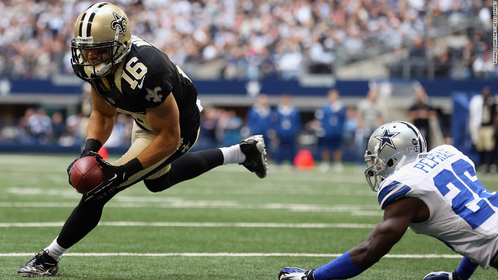 Lance Moore of the Saints runs for a touchdown past Charlie Peprah of the Cowboys on Sunday.