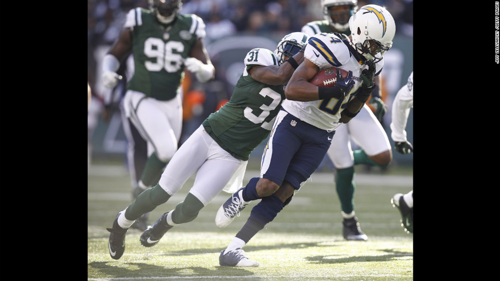 Antonio Cromartie of the Jets takes down Danario Alexander of the Chargers on Sunday.