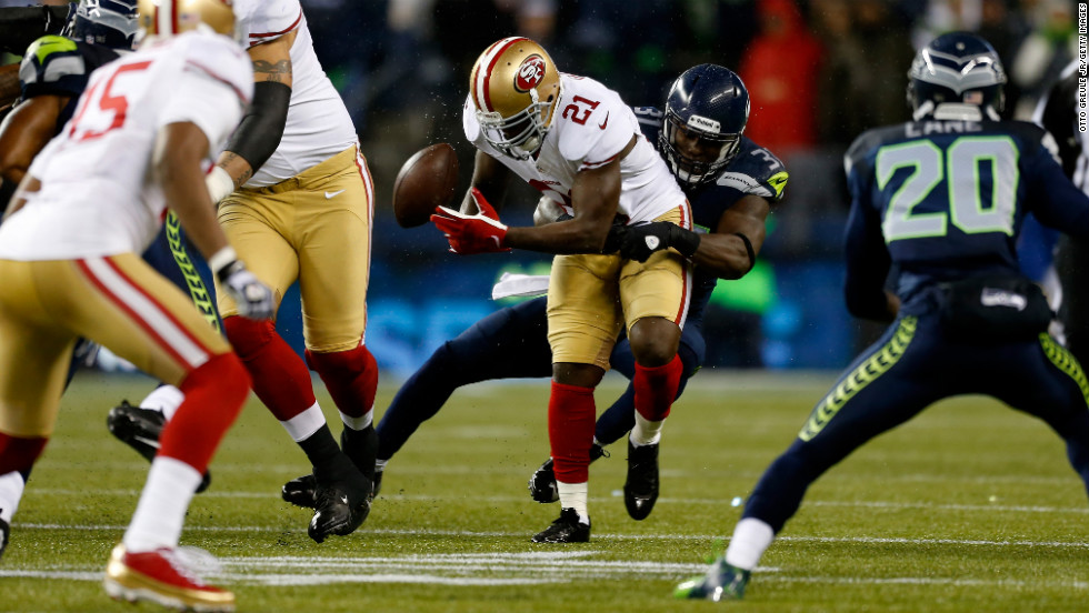 Frank Gore of the San Francisco 49ers fumbles the ball on Sunday.