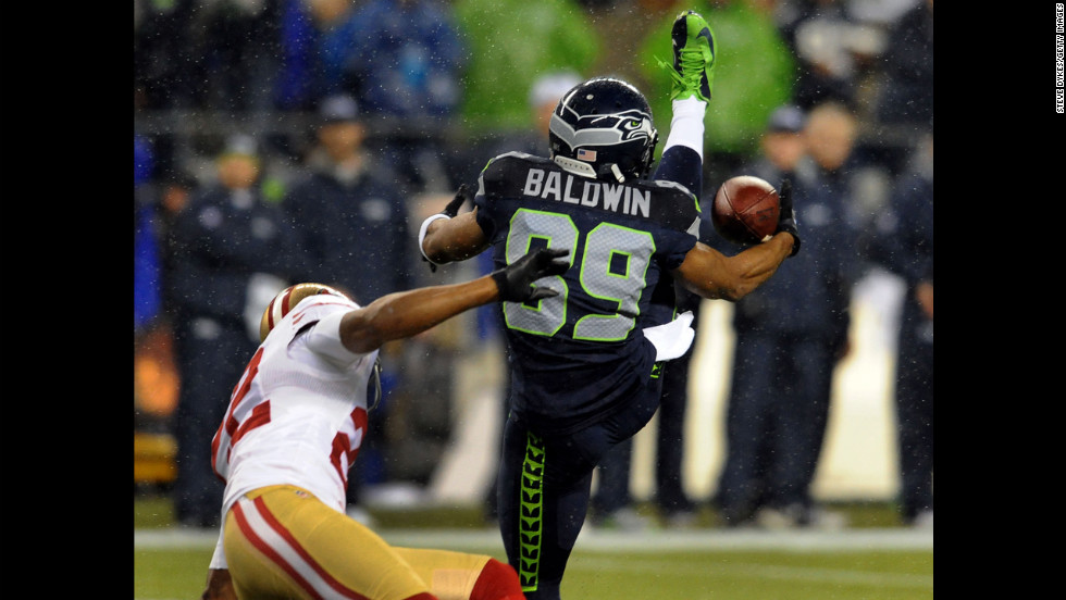 Wide receiver Doug Baldwin of the Seattle Seahawks goes up for a catch against cornerback Carlos Rogers of the San Francisco 49ers on Sunday.