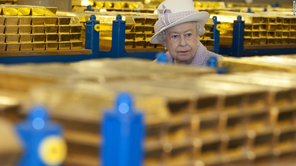 The monarch views stacks of gold as she visits the Bank of England with Prince Philip, Duke of Edinburgh, on December 13, 2012 in London. The royal couple viewed banknotes, counterfeit currency, a gold vault and met with gold experts while on their visit to the central bank.