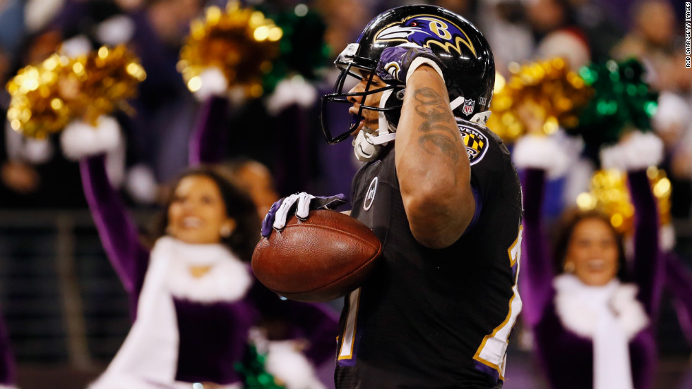 Running back Ray Rice of the Ravens celebrates after catching a first half touchdown pass against the Giants on Sunday.