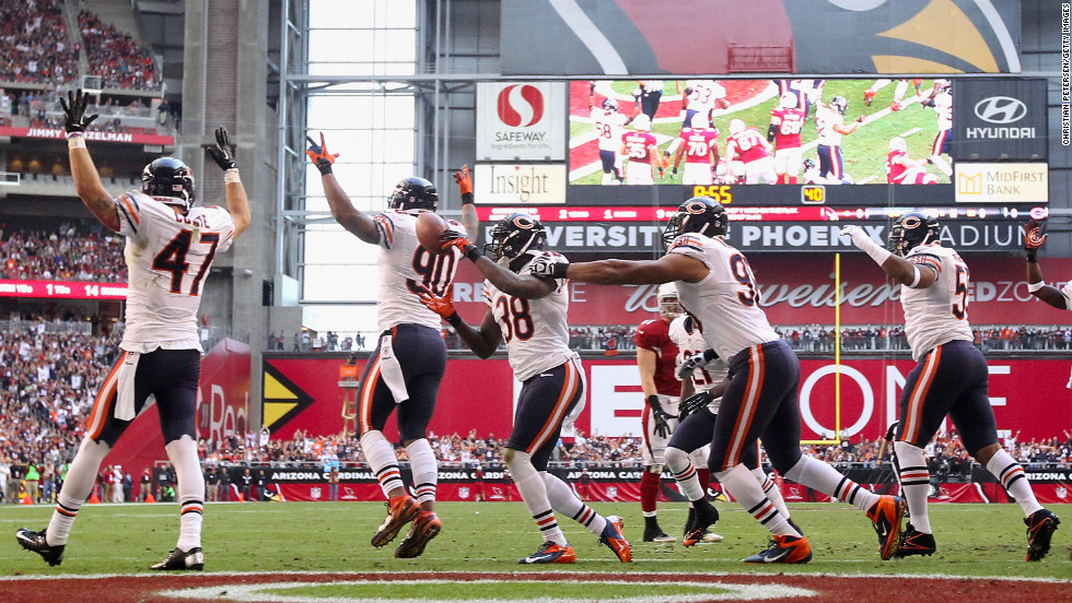 Defensive back Zack Bowman of the Chicago Bears celebrates with teammates after he scores a one-yard touchdown on a fumble recovery against the Arizona Cardinals during the first quarter on Sunday in Glendale, Arizona.