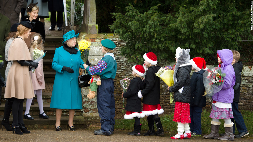 Queen Elizabeth receives flowers from children as she leaves the Royal family Christmas Day church service at St. Mary Magdalene Church in Norfolk, England.