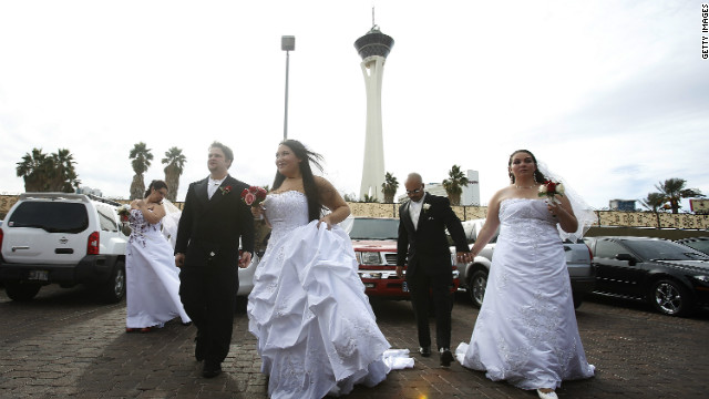 Newlyweds await their wedding photos at the Little Chapel of the Flowers in Las Vegas on December 12, 2012.
