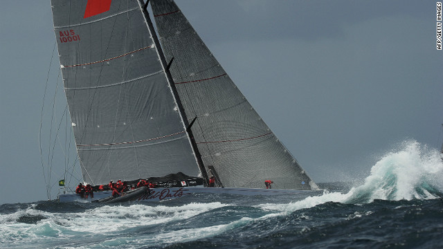 Supermaxi Wild Oats XI enters open water after sailing out of Sydney Harbor in rough conditions on December 26.