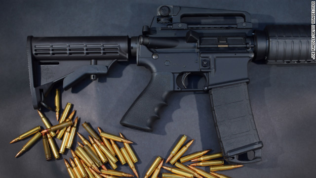 MIAMI, FL - DECEMBER 18: In this photo illustration, a Rock River Arms AR-15 rifle is seen with ammunition on December 18, 2012 in Miami, Florida. The weapon is similar in style to the Bushmaster AR-15 rifle that was used during a massacre at an elementary school in Newtown, Connecticut. Firearm sales have surged recently as speculation of stricter gun laws and a re-instatement of the assault weapons ban following the mass shooting. (Photo illustration by Joe Raedle/Getty Images)
