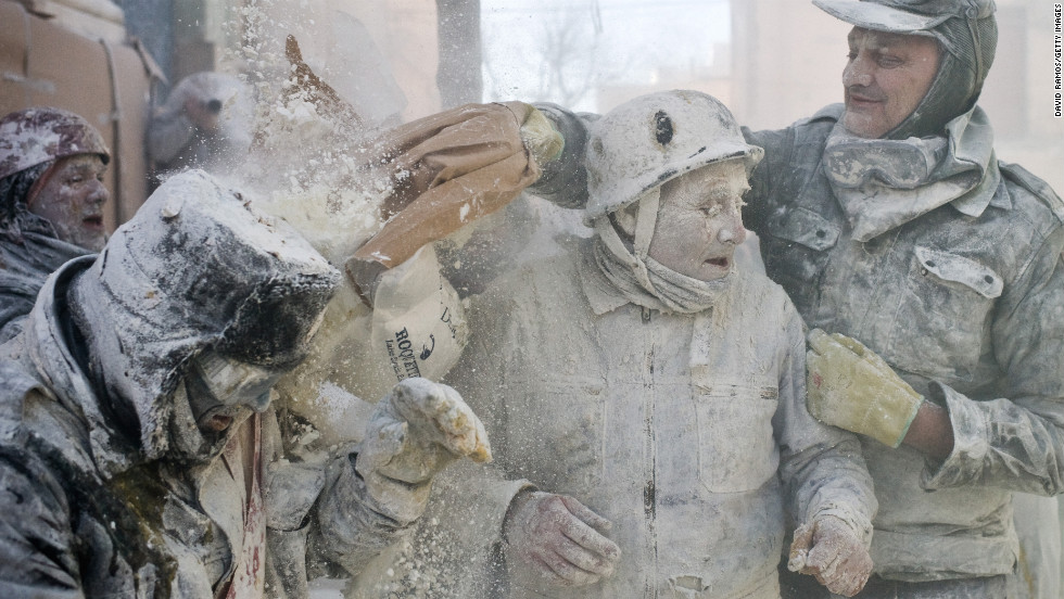 A man throws flour during the battle on December 28.