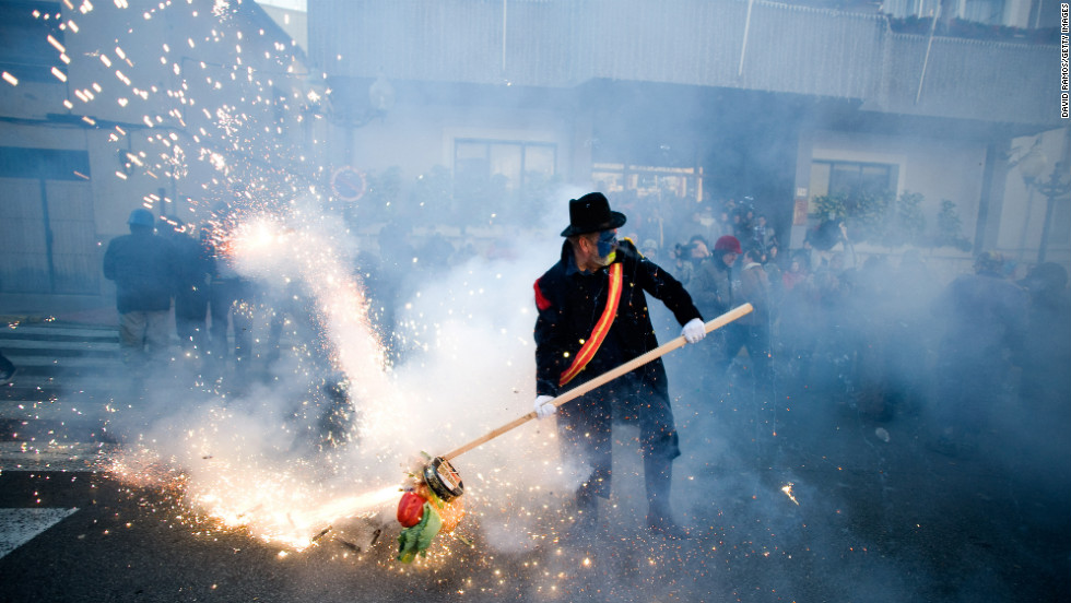 A man participates in the mock battle of Els Enfarinats on December 28.