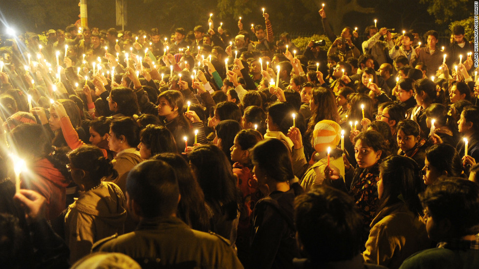 Protesters hold candles during a vigil in New Delhi on Saturday, December 29, after the death of a gang-rape victim. Authorities erected security barriers throughout New Delhi's key government district after two days of street battles following a woman's gang rape on a bus on December 16. Indian Prime Minister Manmohan Singh has appealed for calm and pledged safety for women and children.