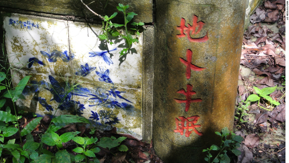Chinese porcelain tile decorates a grave in Bukit Brown cemetery.
