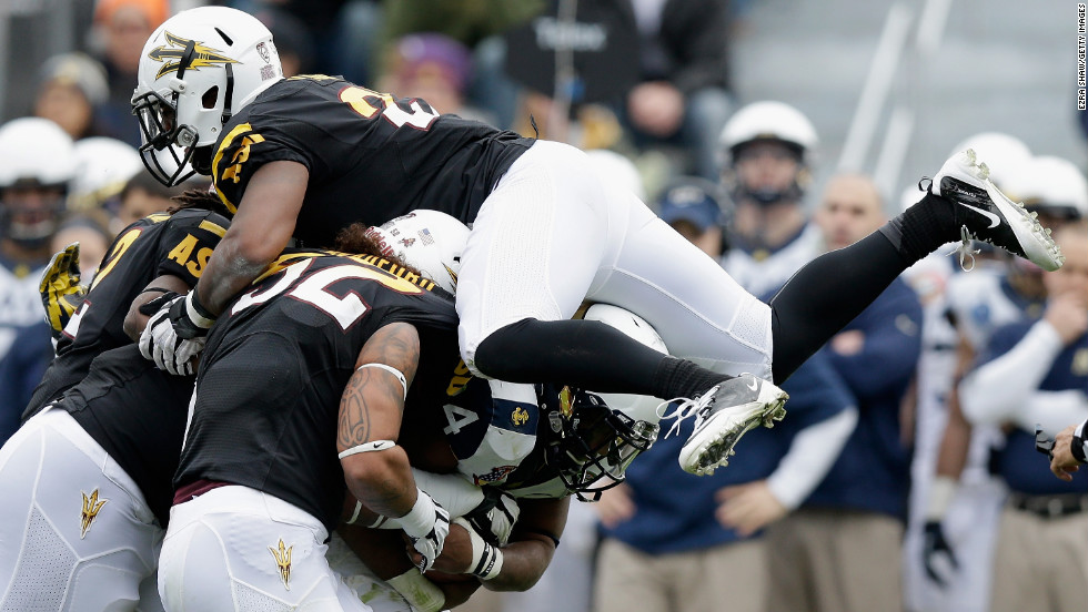Chris Young of the Arizona State Sun Devils jumps on the pile to stop Noah Copeland of the Navy Midshipmen during the Kraft Fight Hunger Bowl.