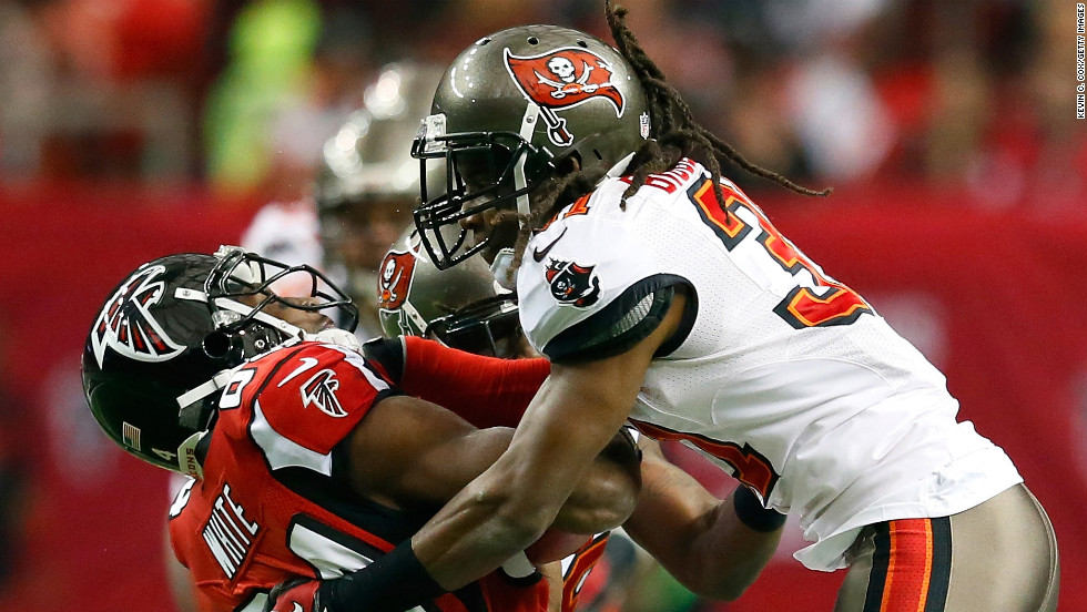 E.J. Biggers of the Tampa Bay Buccaneers tackles Roddy White of the Atlanta Falcons after a reception on Sunday.
