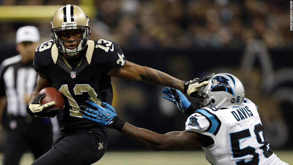 Joe Morgan of the New Orleans Saints stiff arms Thomas Davis of the Carolina Panthers on Sunday.