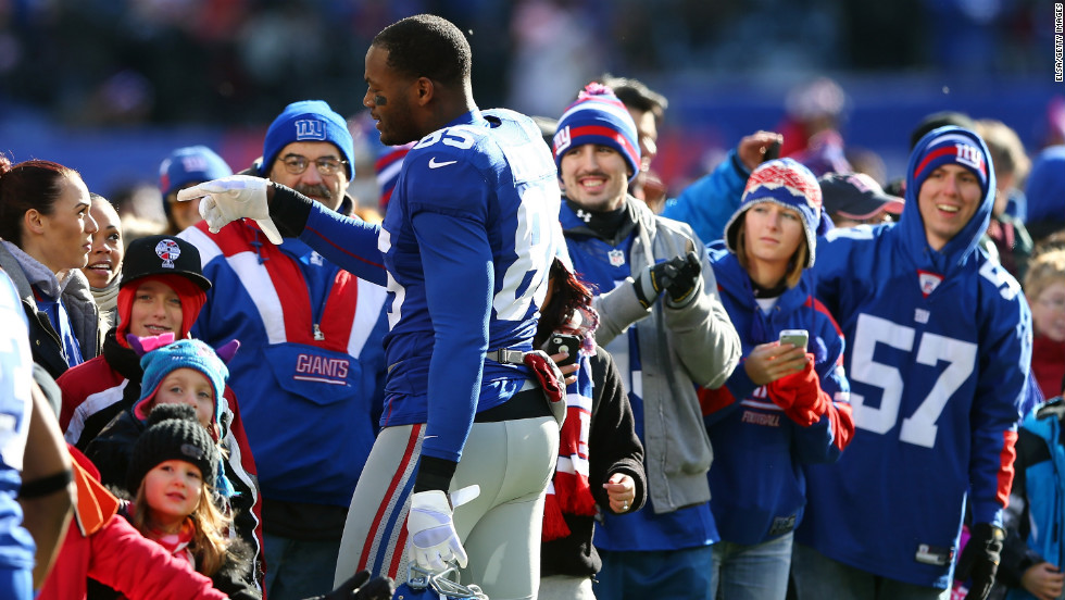 Martellus Bennett of the New York Giants greets families from Sandy Hook Elementary School before the New York Giants and the Philadelphia Eagles game at MetLife Stadium on Sunday in East Rutherford, New Jersey.