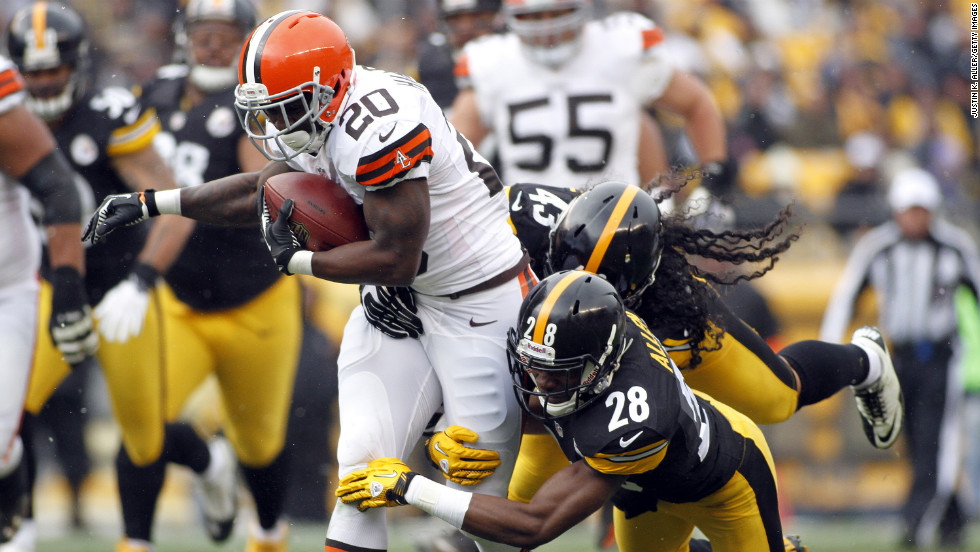 Montario Hardesty of the Cleveland Browns carries the ball against Troy Polamalu and Cortez Allen of the Pittsburgh Steelers on Sunday at Heinz Field in Pittsburgh.