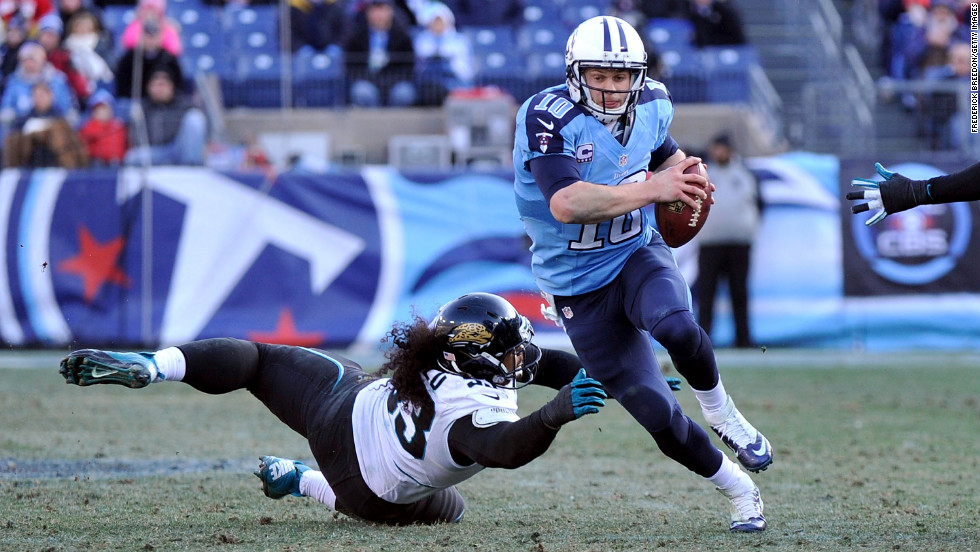 Tyson Alualu of the Jacksonville Jaguars dives to try to sack quarterback Jake Locker of the Tennessee Titans on Sunday.