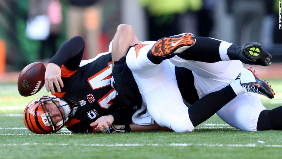 Andy Dalton of the Cincinnati Bengals fumbles the ball on Sunday.