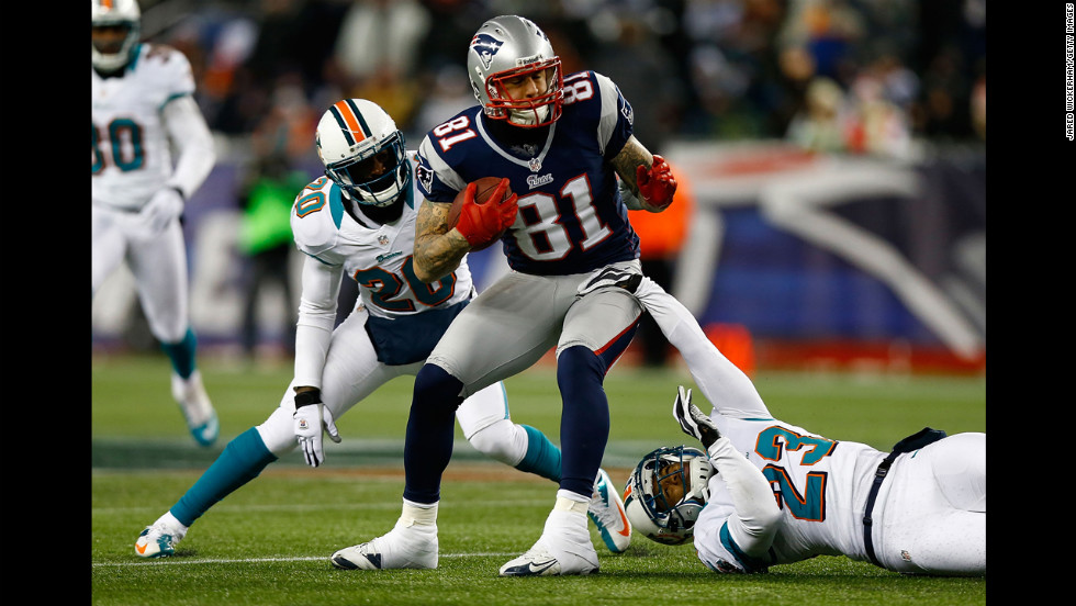 Aaron Hernandez of the New England Patriots avoids a tackle by Bryan McCann of the Miami Dolphins after catching a pass on Sunday.
