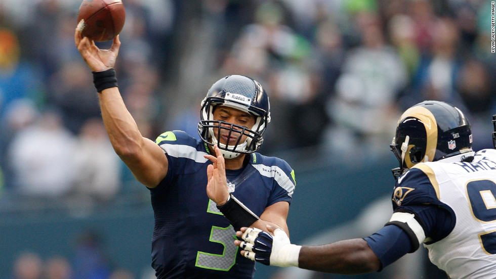 Russell Wilson of the Seattle Seahawks throws under pressure from the St. Louis Rams on Sunday.