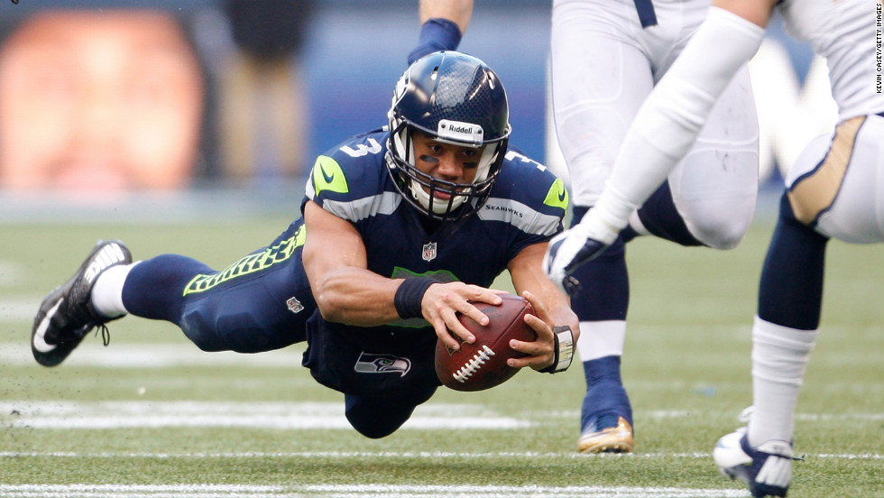Russell Wilson of the Seattle Seahawks dives for extra yardage against the St. Louis Rams on Sunday.