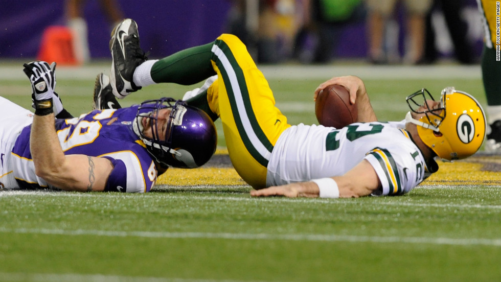 Jared Allen of the Minnesota Vikings sacks Aaron Rodgers of the Green Bay Packers on Sunday.