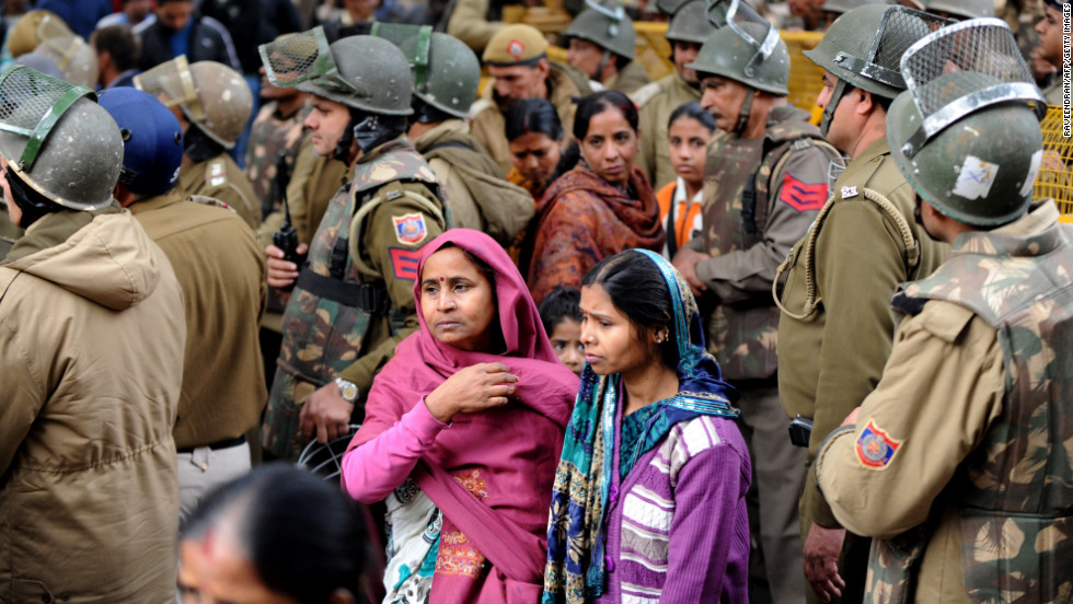 Indian protesters walk with police officials during a rally in New Delhi on Sunday, December 30, following the cremation of a gang-rape victim in the Indian capital. The 23-year-old student died Saturday and was cremated at a private ceremony, hours after her body was flown home from Singapore. She had been gang-raped and severely beaten on December 16, triggering an outpouring of grief and anger across India.