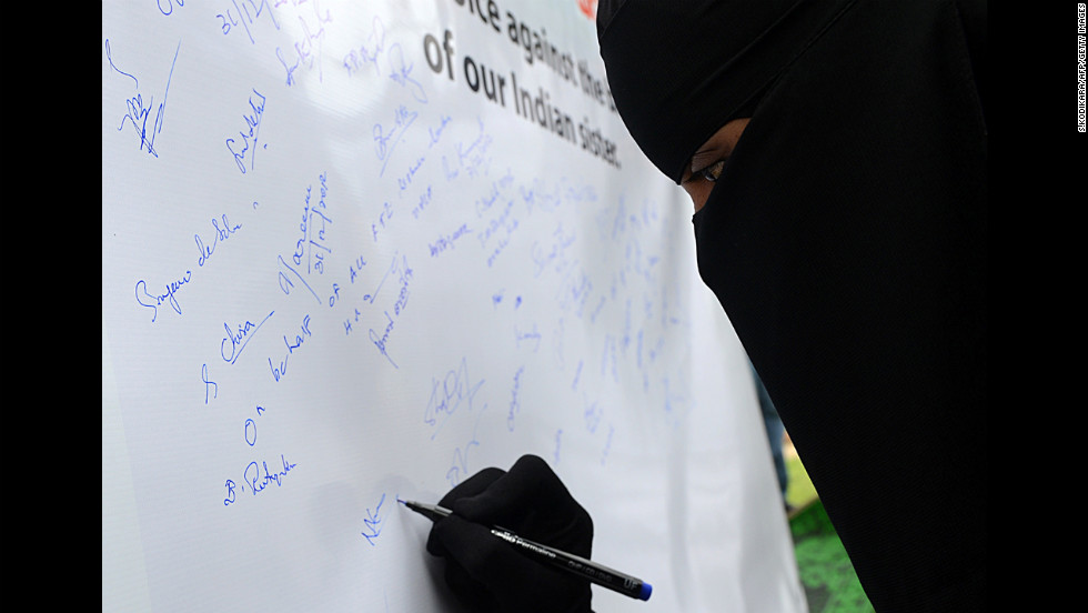 A Sri Lankan opposition United National Party activist places her signature on a banner in memory of the Indian gang-rape victim in Colombo on December 31.