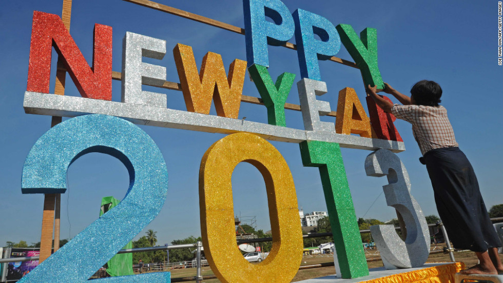 A worker puts up a sign ahead of Myanmar's first public New Year countdown celebration at the Myoma grounds in Yangon on Monday.