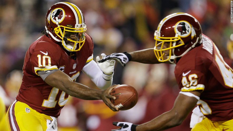 "Quarterback Robert Griffin III of the Washington Redskins hands off to Alfred Morris during the game against the Dallas Cowboys on Sunday, December 30, at FedEx Field in Landover, Maryland. Check out the action from Week 17 of the NFL and then <a href=""http://www.cnn.com/2012/12/22/worldsport/gallery/nfl-week-16/index.html"">look back at the best photos from Week 16</a>."