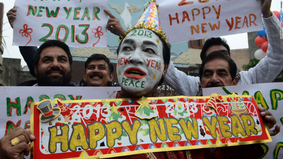 Indian revelers hold signs in Amritsar on Monday.