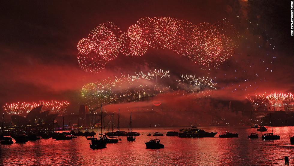 Boats dot Sydney Harbour as New Year's Eve fireworks erupt over the Sydney Harbour Bridge.