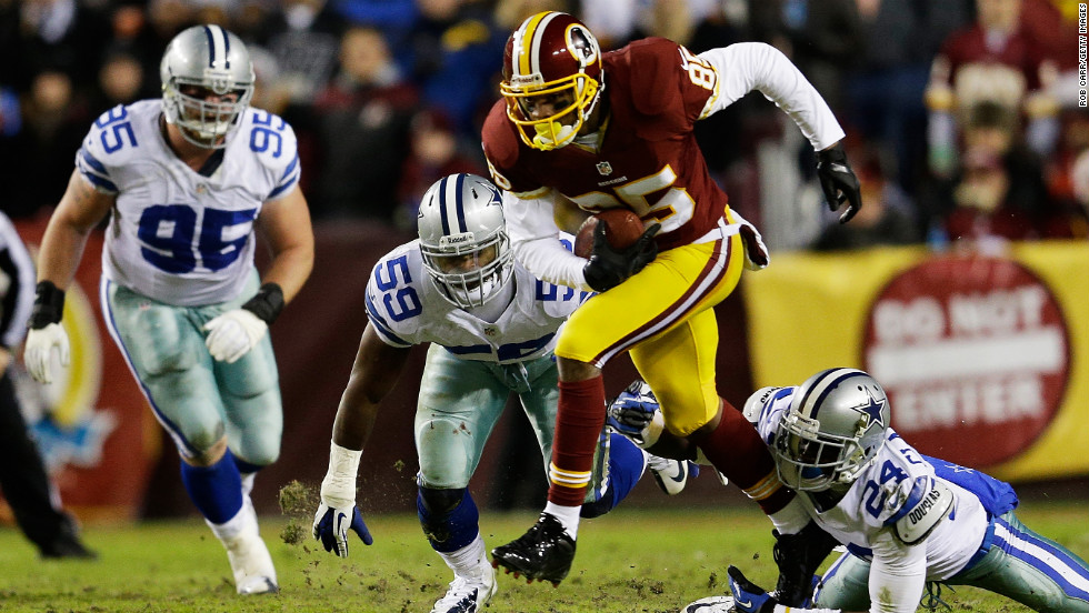 Leonard Hankerson of the Washington Redskins breaks the tackle of Morris Claiborne of the Dallas Cowboys on Sunday.
