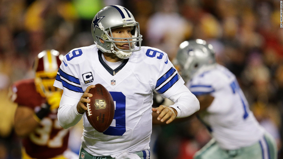 Cowboys quarterback Tony Romo drops back to pass against the Redskins on Sunday.